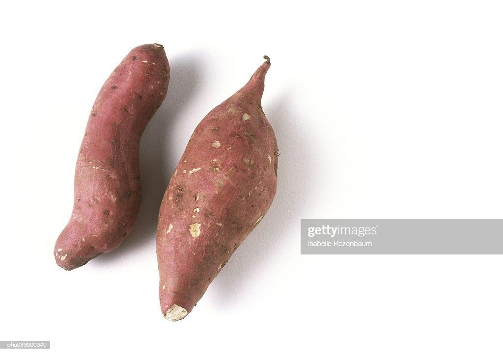 Two sweet potatoes, full length : Stockfoto