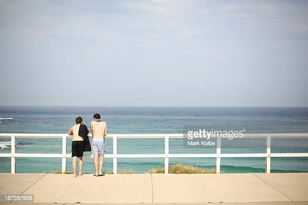 Two swimmers stop to watch the surfers between Bronte and Tamarama beaches on December 1 2012 in Sydney Australia Temperatures in the high 30s have...