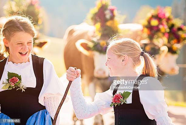 two swiss farmer girls having fun during aelplerfest parade - traditional clothing stock pictures, royalty-free photos & images