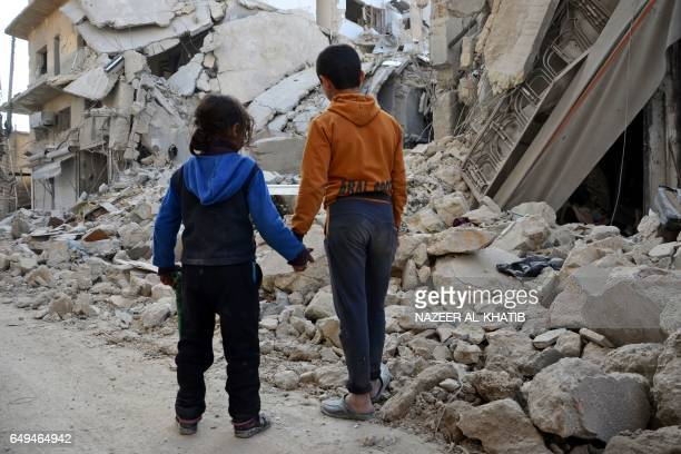 TOPSHOT Two Syrian children stand by in front of the rubble of a destroyed house in the northern Syrian town of alBab after Turkishbacked rebels...