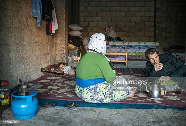 Two Syrian Kurdish Man and woman fled from clashes between the Islamic State of Iraq and Levant militants and proKurdish Democratic Union Party...