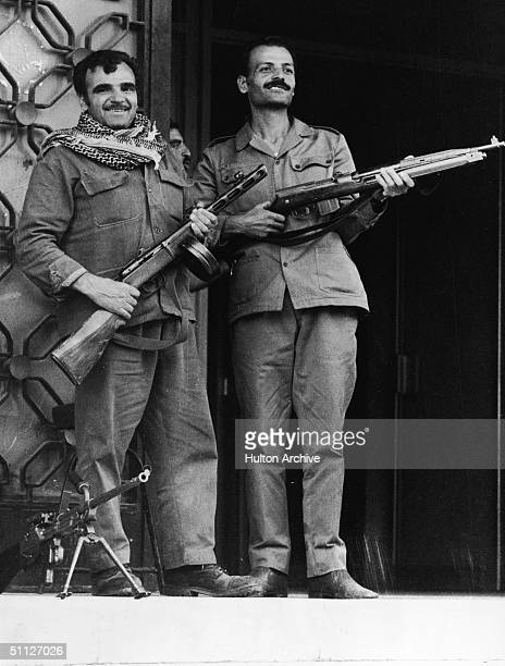 Two Syrian soldiers keep watch in Damascus during the Yom Kippur War, October 24, 1973. The one on the left holds a Soviet-built PPS-41 submachine...