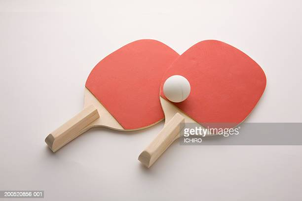 Two table tennis rackets with ball, elevated view
