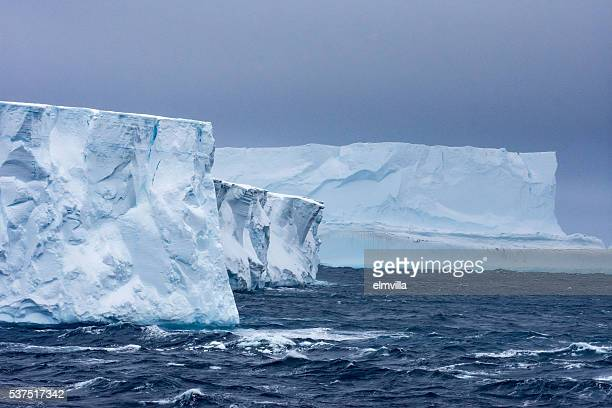 Two tabular icebergs in Antarctica