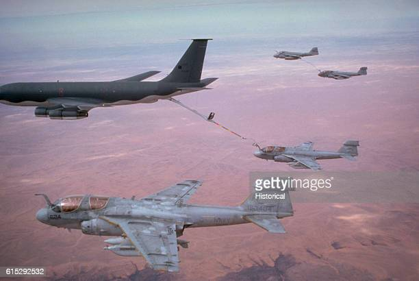 Two Tactical Electronic Warfare Squadron 130 EA6B Prowler aircraft rendezvous with a KC135E Stratotanker aircraft to refuel while en route to targets...