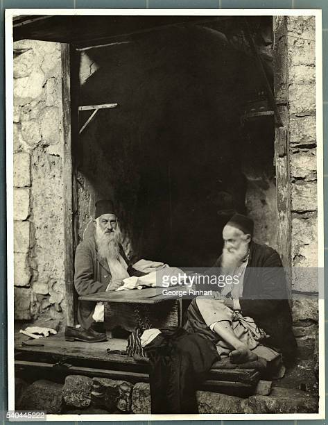 Two tailors in the Jewish section of Jerusalem sit in one of the subterranean streets