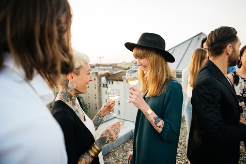 Two tattooed friends at rooftop party - gettyimageskorea