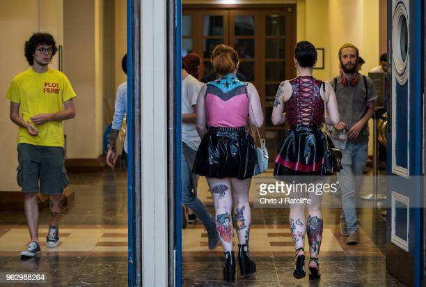 Two tattooed women walk out of the Great British Tattoo Show at Alexandra Palace on May 27 2018 in London England The show hosts over 300 tattooo...
