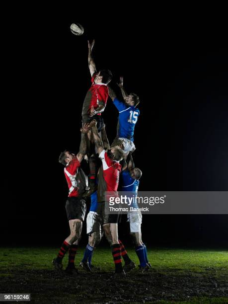 two teams jumping for ball in rugby lineout - rugby photos et images de collection