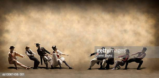 two teams of mimes playing tug of war - mime stock photos and pictures
