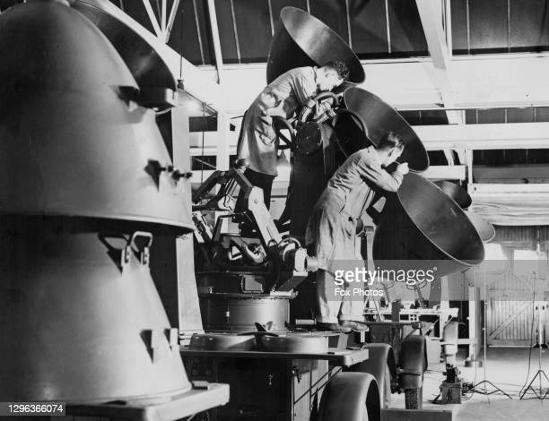 Two technicians assemble a mobile anti-aircraft acoustic sound detection and locator device that will be used to pin point the location of incoming...