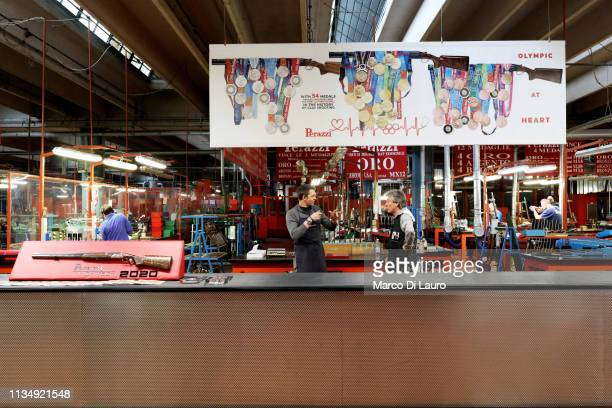 Two technicians at the customer service talks to each other on April 4 2019 at the Perazzi Armi factory in Botticino Mattina a village in the...