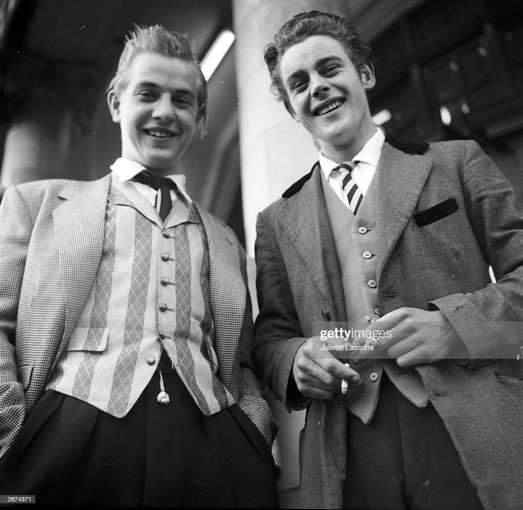 Two Teddy boys, one with striped waistcoat and the other with a velvet collared jacket.