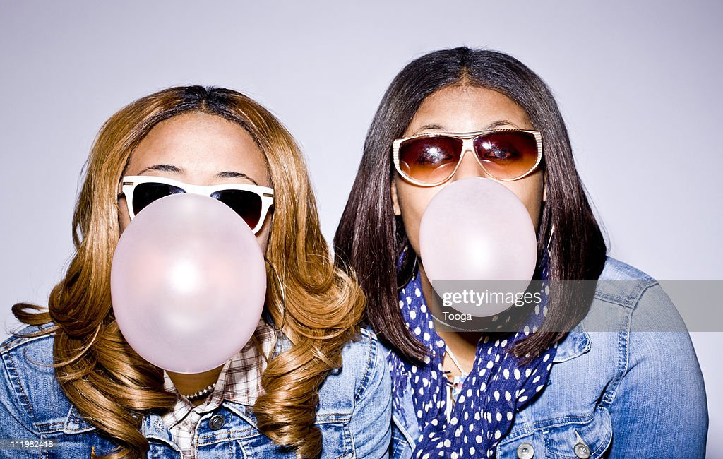 Two teen girls blowing bubbles : Stock Photo