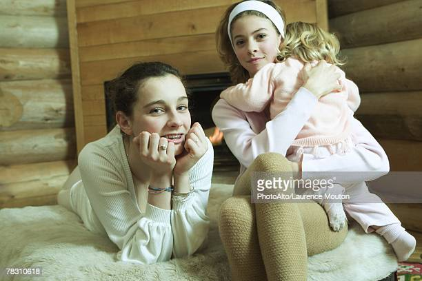 two teen girls with little sister, smiling at camera - teen girls in tights stock photos and pictures