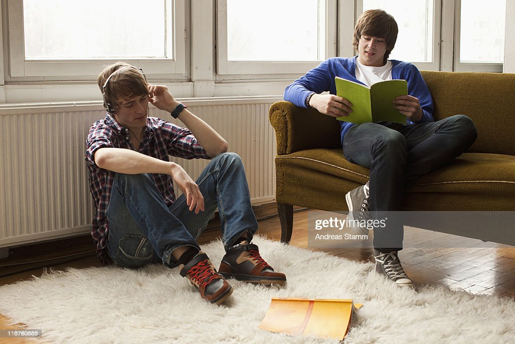 Two Teenage Boys Hanging Out In A Living Room : Stock Photo