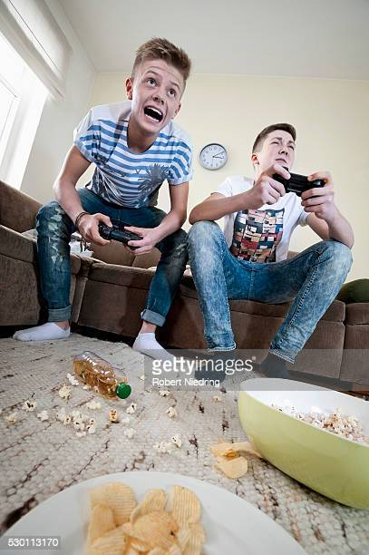 Two teenage boys playing video game