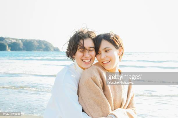 two teenage girl laughing while talking - yusuke nishizawa stock pictures, royalty-free photos & images