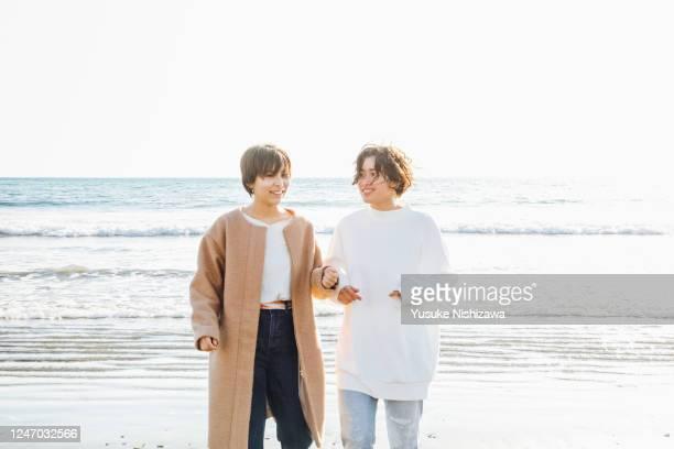 two teenage girl laughing while talking - yusuke nishizawa stock pictures, royalty-free photos & images