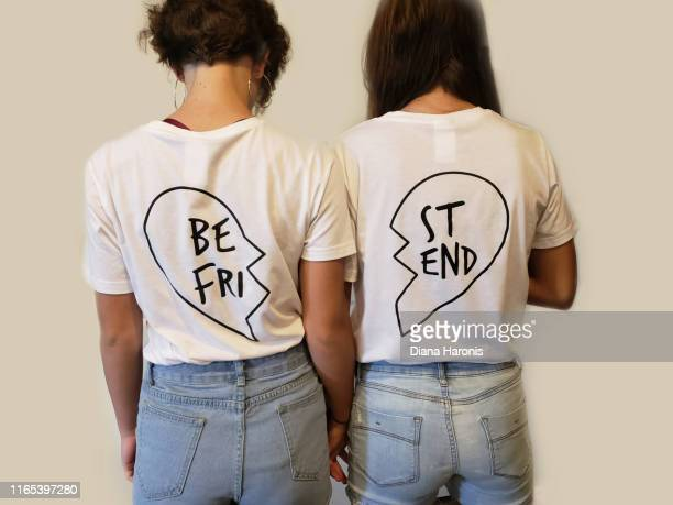 two teenage girls are wearing best friend shirts. - graphic t shirt stock pictures, royalty-free photos & images