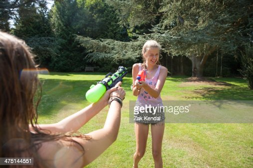 Two Teenage Girls Firing Water Guns In Garden High-Res Stock Photo - Getty Images-9743