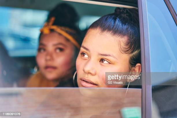 two teenage girls in car back seat looking out of car window, close up - south yorkshire stock pictures, royalty-free photos & images