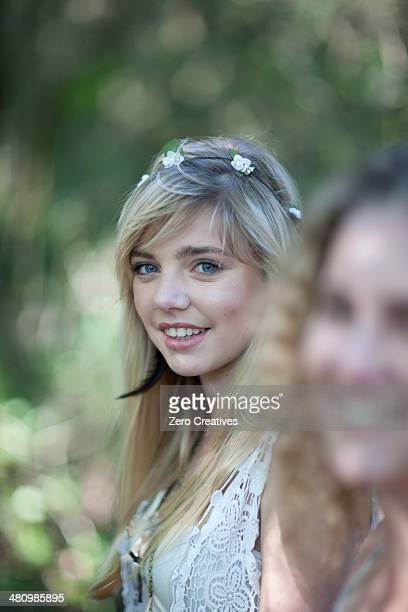 Two teenage girls in woodland