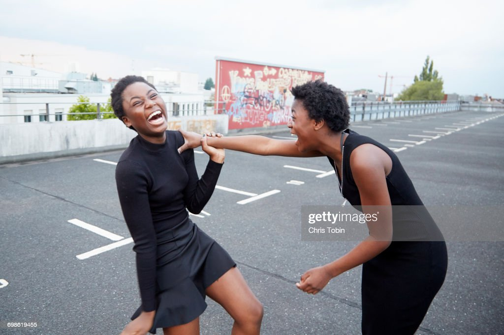 Two teenage girls laughing together : Stock Photo