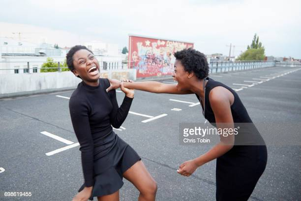 Two teenage girls laughing together