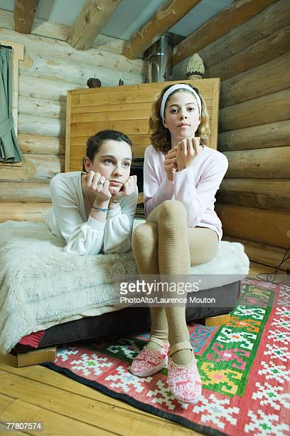 two teenage girls on bed, looking at camera - teen pantyhose stock photos and pictures