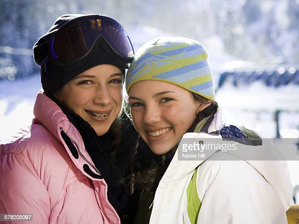 two teenage girls outdoors in winter with toques - headwear stock pictures, royalty-free photos & images