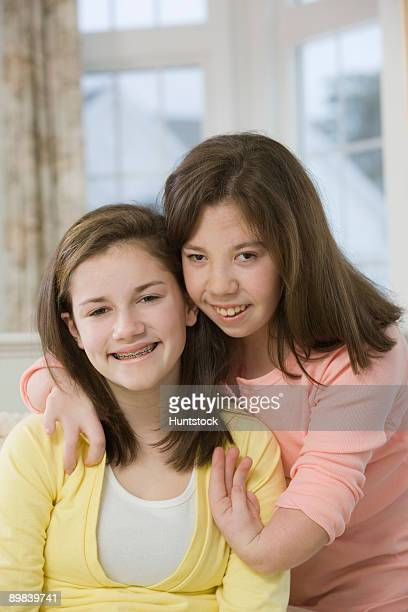 two teenage girls smiling together - deformed hand stock pictures, royalty-free photos & images