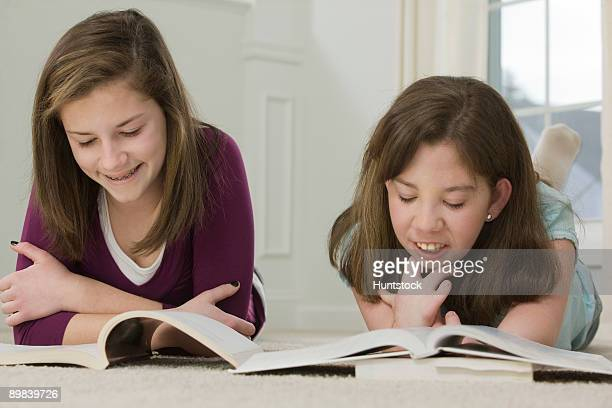 two teenage girls studying together - deformed hand stock pictures, royalty-free photos & images