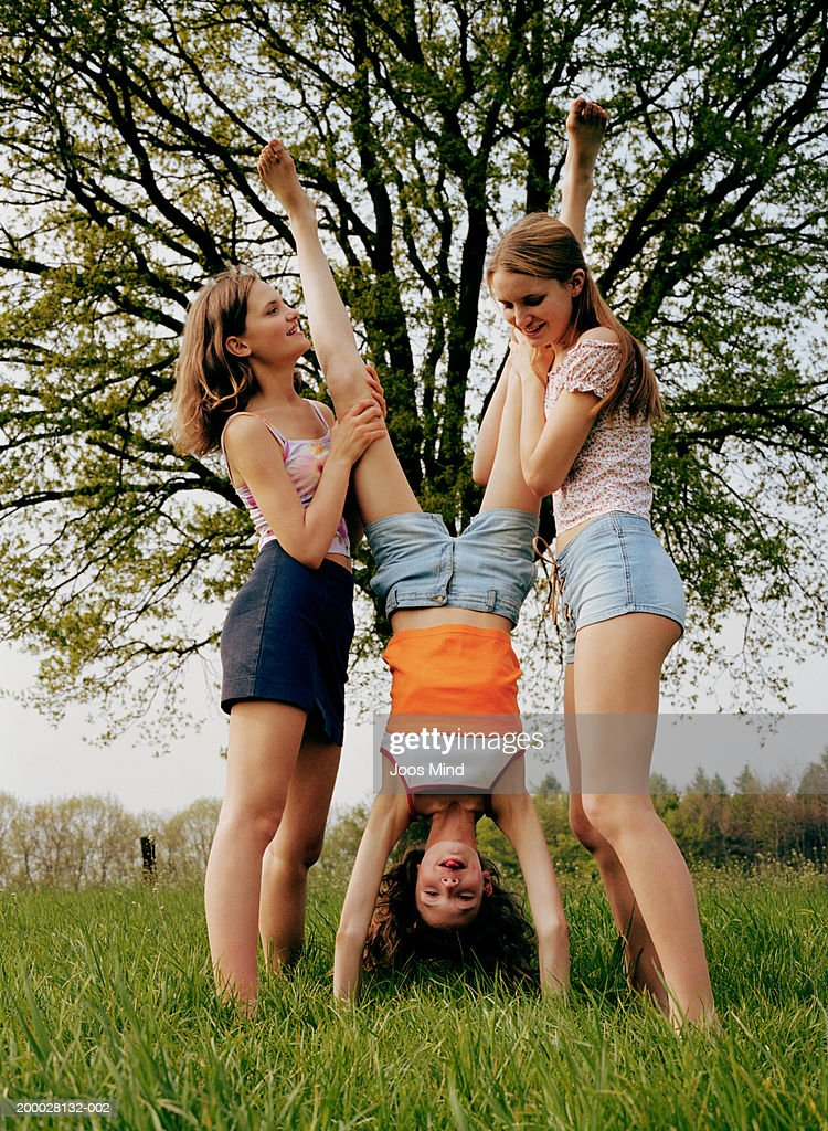 Two Teenage Girls Doing Handstand Stock Photo