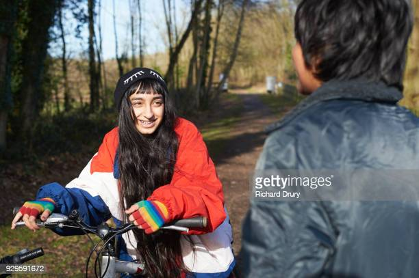 Two teenage girls talking on cycle track