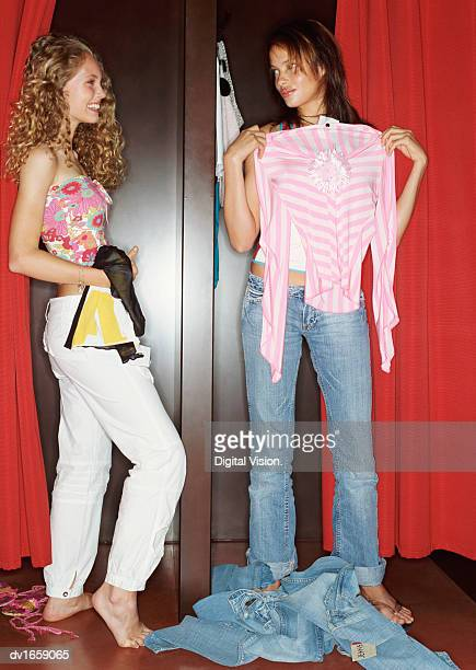 Two Teenage Girls Trying on Clothes in a Fitting Room