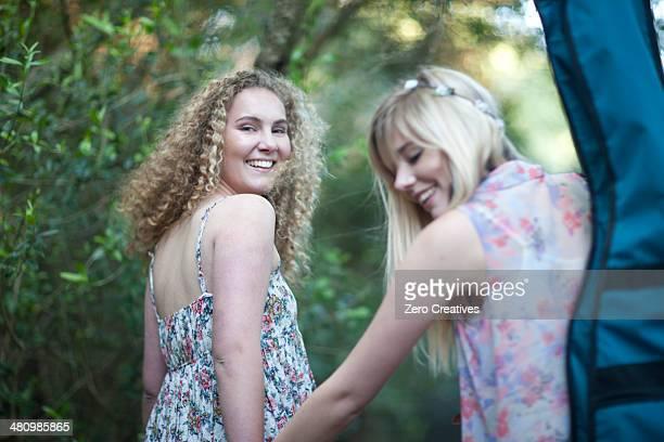 Two teenage girls walking in woodland