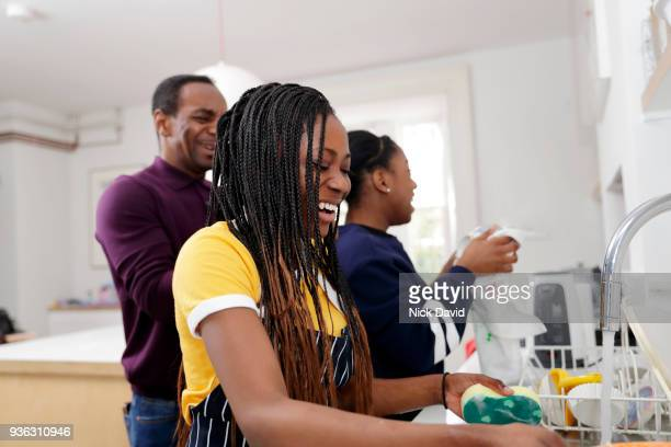 two teenage girls (12-13, 14-15) washing dishes - chores stock pictures, royalty-free photos & images