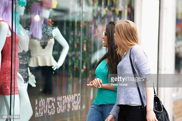 Two teenage girls window shopping