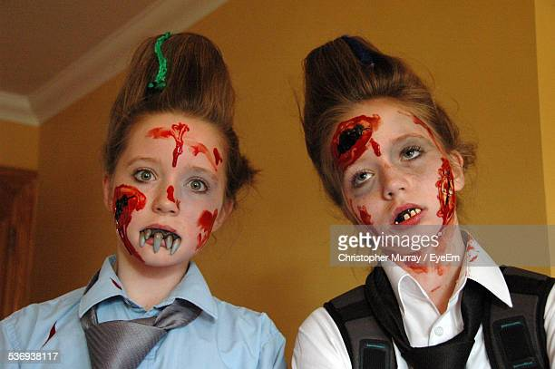 two teenage girls with painted faces - zombie face stock photos and pictures