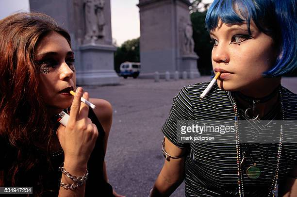 Two Teenage Punk Girls Smoking Cigarettes