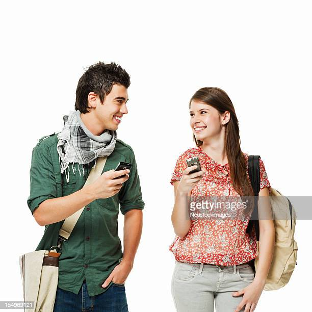Two Teenage Students With Cellphones - Isolated