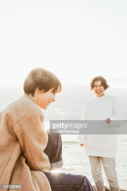 two teenager girl laughing while talking - yusuke nishizawa stock pictures, royalty-free photos & images
