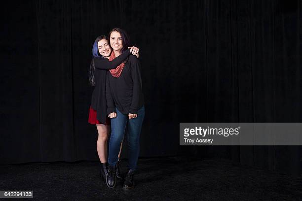 two teenager girls hugging. - only teenage girls stock pictures, royalty-free photos & images