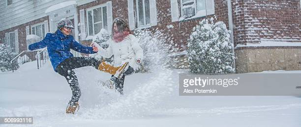 two teenager girls under snowfall at the street - queens new york city stock pictures, royalty-free photos & images
