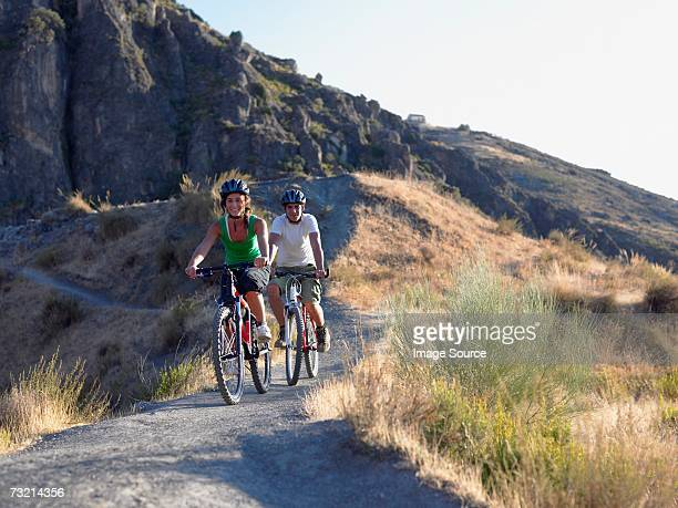 two teenagers cycling - andalucia stock pictures, royalty-free photos & images