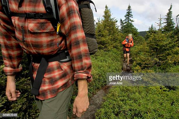 two teenagers hike in the mahoosuc range, the most rugged section of the appalachian trail. - appalachian trail stock pictures, royalty-free photos & images