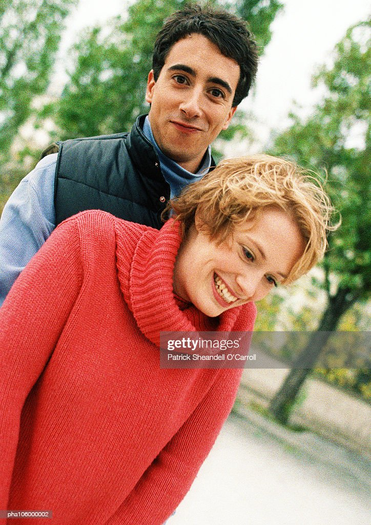 Two teenagers in park, smiling : Stockfoto