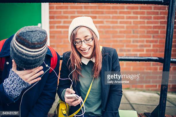 Two teenagers laughing together