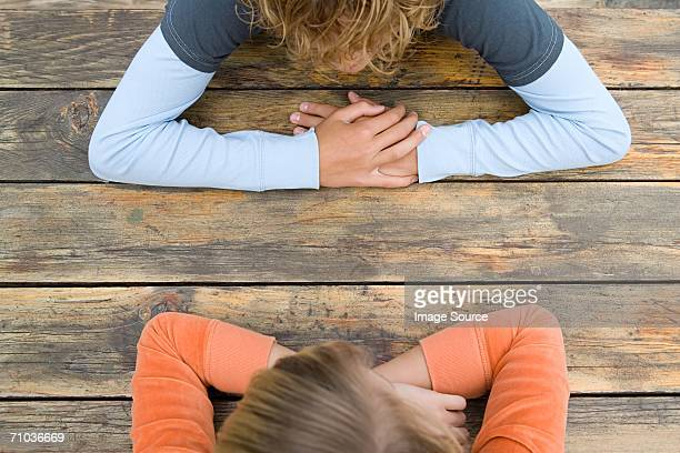 Two teenagers sat facing each other